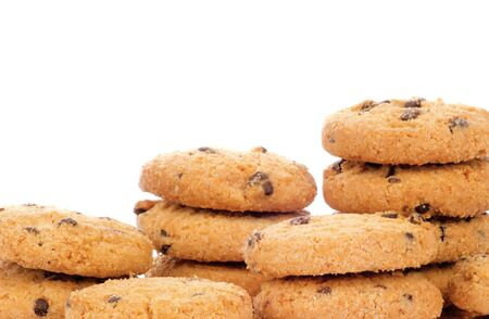 A stack of chocolate chip cookies isolated on a white background  photo