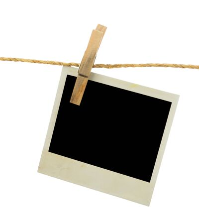 Three blank instant photos hanging on the clothesline. Isolated on white background. photo
