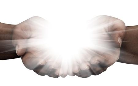 Die handen openen met gloeiende lichten