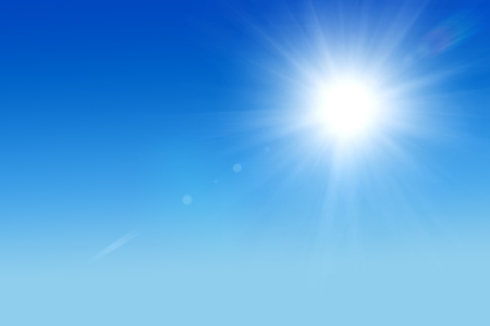 Shining sun at clear blue sky with copy space Stock Photo