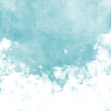 Sky, fog, and clouds on a textured, vintage paper background with grunge stains Banco de Imagens