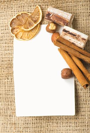 Menu Design.Old paper, coffee bean, cinnamon, lemon, burlap. photo