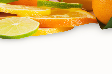 sliced fruit: Citrus sliced fruit isolated on white Stock Photo
