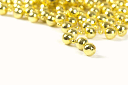 ornamentations: Background made of a brilliant celebratory beads of golden color over white