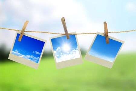 pack string: Three instant photos with sky inside hanging on the clothesline