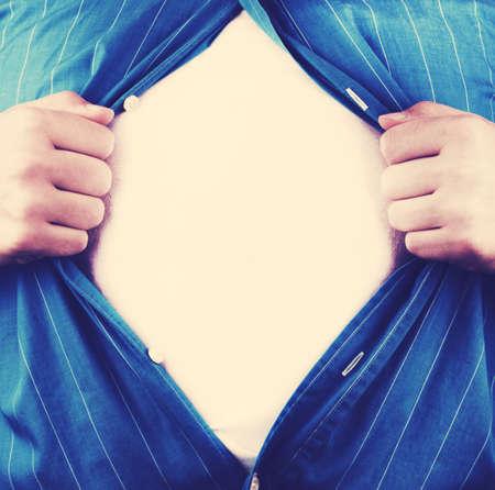 tearing: Business man tearing off his shirt