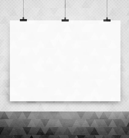 white poster: white poster on a wall Stock Photo