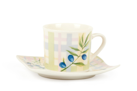fine china: Fine china cup and saucer filled  isolated on white