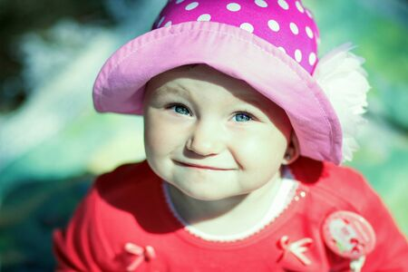 pink hat: little girl in pink hat on a sunny day Stock Photo