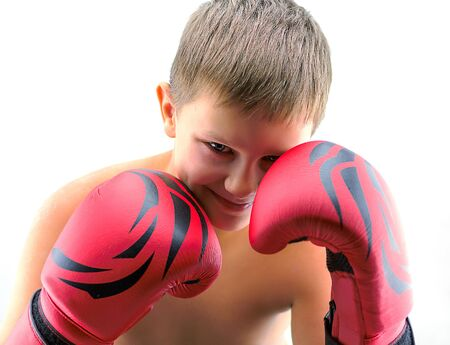 boy boxing: Portrait of a boy in red boxing gloves