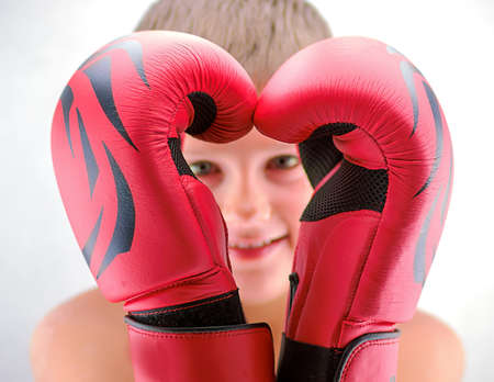 boxing boy: Portrait of a boy in red boxing gloves