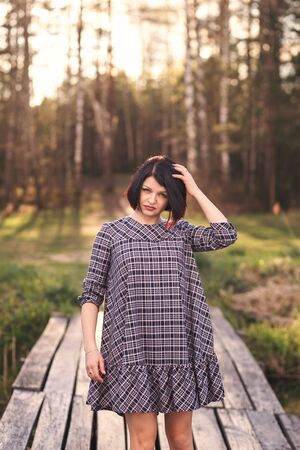 portrait of a young cute girl with short hair on summer nature