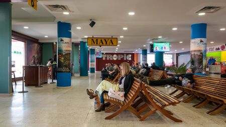 Belize City, Belize - November, 18, 2019. Passengers waiting for their flights inside international Philip S W Goldson Airport. Editorial