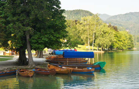 view of Lake Bled, Julian Alps and boats, sunny day, Bled, Slovenia