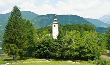 view of the Church of St. John the Baptist, Julian Alps mountains, Bohinj, Slovenia