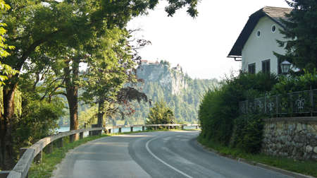 Road around the Bled lake, Julian Alps mountains and Bled Castle, sunny day, Bled Stockfoto