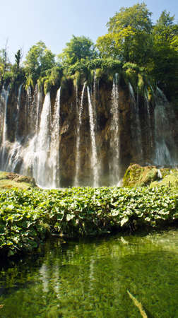 Waterfall and rock, beautiful nature landscape, Plitvice Lakes in Croatia, National Park