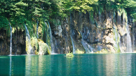 Waterfalls and hill, beautiful nature landscape, Plitvice Lakes in Croatia, National Park