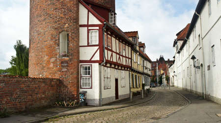 View of the brick wall and part of Halbturm-Haus, a half-timbered house at the street An der Mauer, beautiful architecture, Lubeck Stockfoto