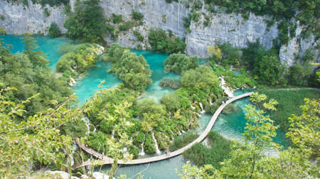 Aerial view of waterfalls and wooden ways in National Park Plitvice Lakes