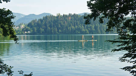 view of Lake Bled with people, Julian Alps mountains, sunny day,Bled, Slovenia