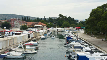 Trogir, Croatia - View of channel with boats near old town, sunny day