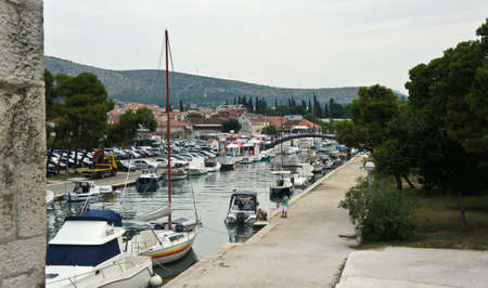 Trogir, Croatia - View of canal with boats near old town, sunny day