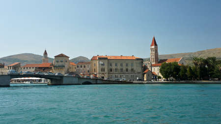 Scenic view of the city with mountain background, beautiful cityscape with bridge, sunny day, Trogir, Croatia