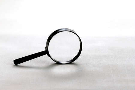 Magnifier glass with shadow isolated on white background. Front view