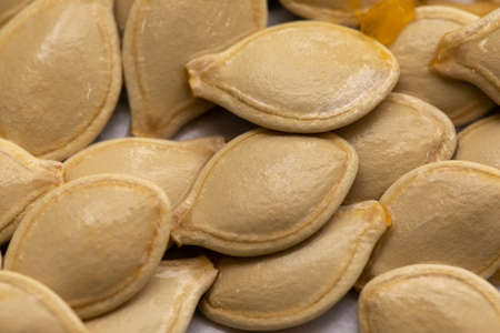 Heap of pumpkin seeds or pepitas background