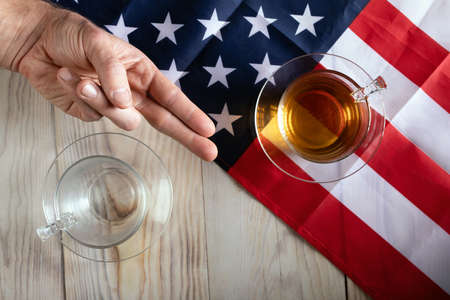 concept of battling each other in US Presidential Election. Two glasses opposite each other on background of American flag