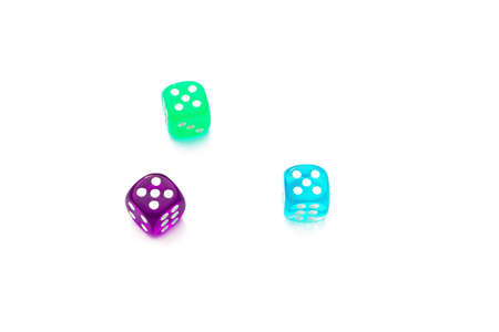 number five on the edges of the die, three multi-colored dice on a white background