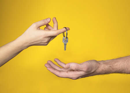 woman gives man key to her heart. Metaphor. concept of wedding, marriage, creating family, living together