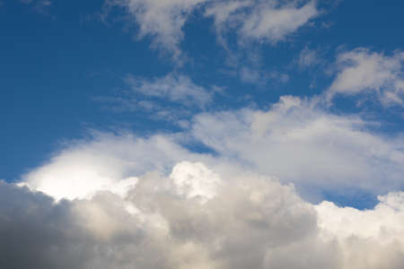 Sky clouds background. Large, big fluffy cumulus cloud. Soft focus and copy space.