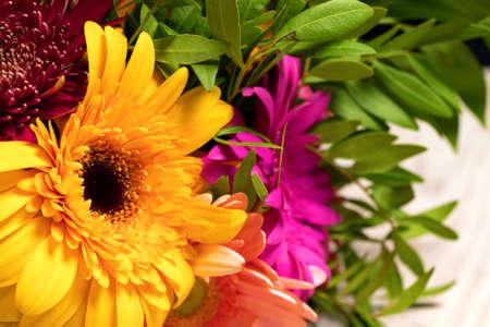 Close-up of large beautiful orange gerbera flower in colorful bouquet of flowers. Gift for holiday or poster for store. Stockfoto