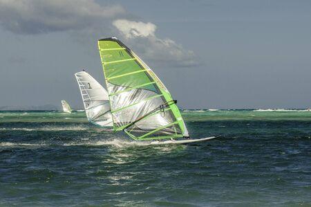windsurfers: Boracay island, Philippines - January 31, 2015: Windsurfers in windy weathers on The Boracay International funboard Cup 2015.