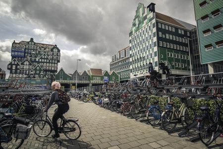 velo: Zaandam, The Netherlands. - June 18, 2015: Parking for bicycles near Inntel Hotels Amsterdam Editorial