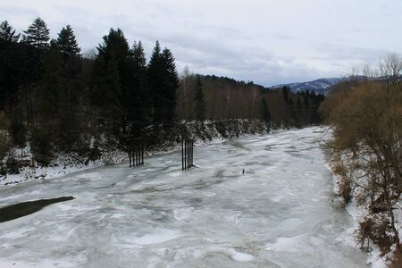 frozen river: Frozen river in Carpathian mountains