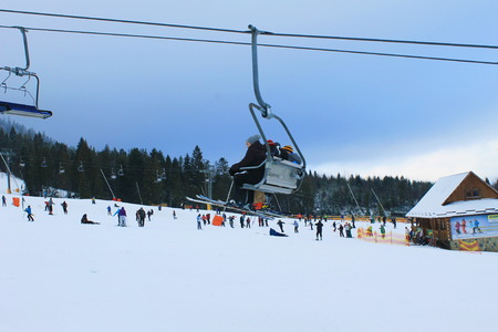 ski lift: Skiers on ski lift in Carpathians