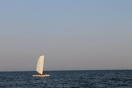 catamaran: White catamaran in the sea Stock Photo