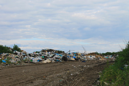 scrapheap: Large garbage dump outside of the city