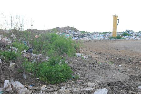 putrefy: Large garbage dump outside of the city