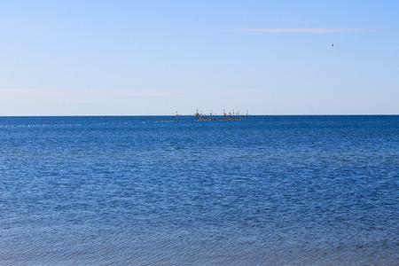 horison: Seascape with fishing nets on horison Stock Photo