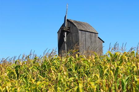 Old wooden windmill on a corn field in Ukraine
