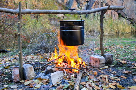 soup kettle: Cooking on a campfire
