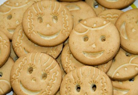 Background of the round smiling  cookies