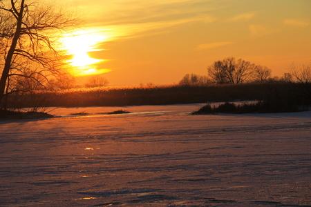 frozen river: Sunset over the frozen river Dnieper on winter