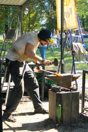blacksmith shop: Myrgorod, Ukraine - August 20, 2016: Blacksmith at work on the festival of blacksmiths