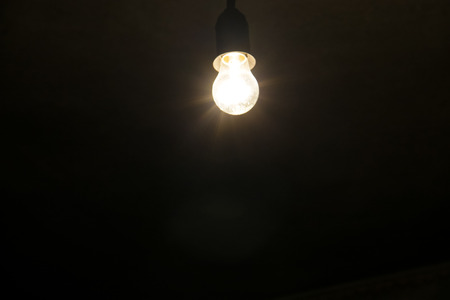 electric bulb: Electric light bulb on the dark backround Stock Photo