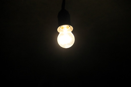 electric bulb: Electric light bulb on the dark background Stock Photo